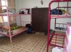 Slaapzaal in het SPI Study House