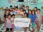 Kinderen van de Rehobothschool doneren wasmachine voor Sunflower KIDS huis in Ho Chi Minh City, Vietnam